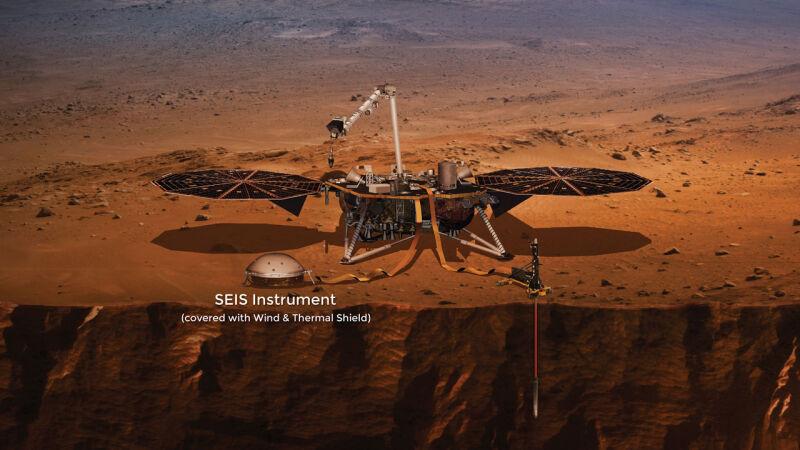 Wizja artystyczna lądownika InSight. Widać na niej sejsmograf (NASA)